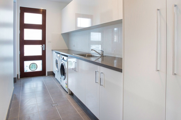 Laundry cabinets by DRK Kitchens